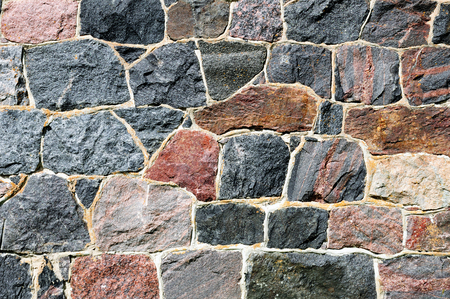 A rough wall made of cemented stones