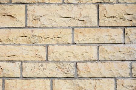 Fragment of decorative gravel brick wall