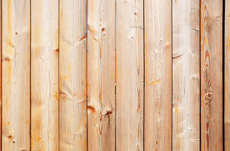Close-up view of a discolored weathered wooden fence texture