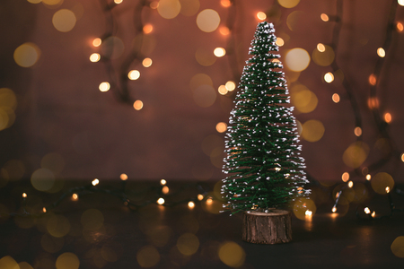 Photo of a Christmas tree surrounded by bokeh lights Stock Photo