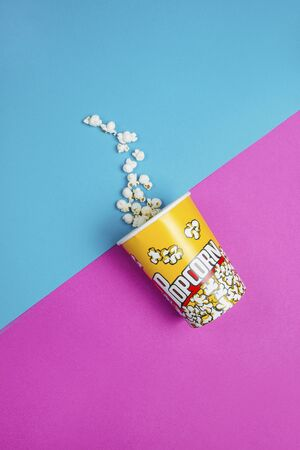 Yellow popcorn box on a blue and purple background
