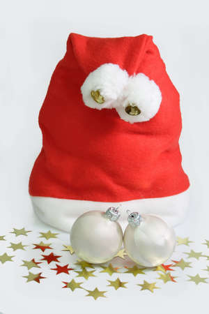trashy: Santa hat with two white christmas tree balls and golden stars on white