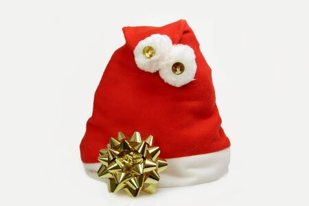 robbon: Santa Claus hat with golden robbon on light background