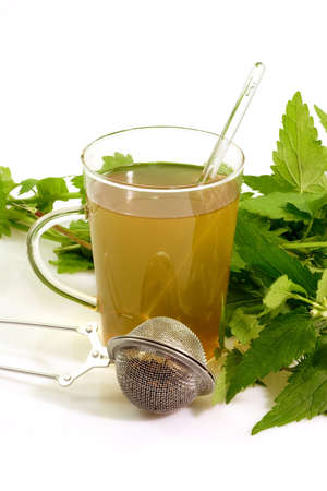 flogging: Herbal tea with fresh stinging nettle Stock Photo