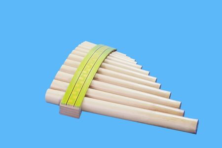 panpipe: Pan flute isolated on blue background