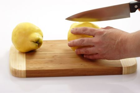 boasting: Bosting quinces on a kitchen board