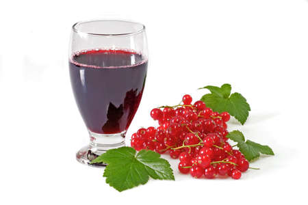 A glass of black currant juice with garnish on light background Stock Photo