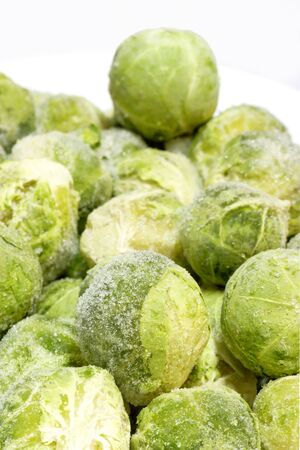 brussel: Frozen organic Brussel sprouts on bright background Stock Photo