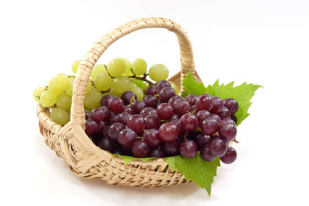 Red and Green grapes in a Basket on a bright background Stock Photo - 2481883