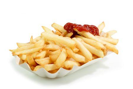 papas fritas: Crujiente de papas fritas en un plato con papel brillante de fondo