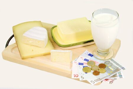 Milk products with Euro banknotes on bright Background photo