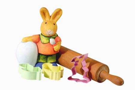 rollingpin: Cookie cutters and rolling pin with easter bunny - isolated on white