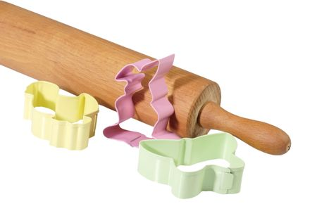 easter cookie: Easter cookie cutters with rolling pin on white background Stock Photo