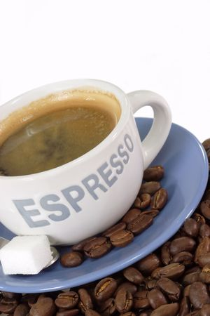 expresso: Expresso coffee with sugar over roasted coffee beans. Stock Photo