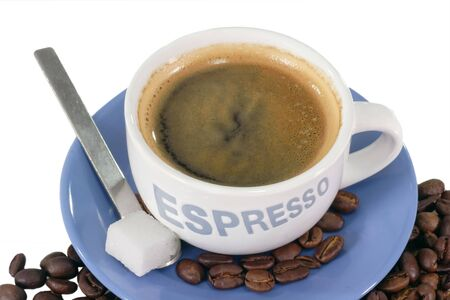 expresso: Expresso coffee  over roasted coffee beans. Stock Photo