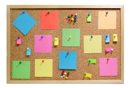 Colorful blank post it notes affixed to the corkboard.