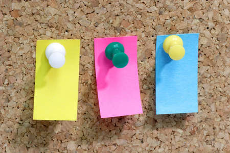 Close up from colorful blank post it note affixed to the corkboard. Stock Photo - 2548504