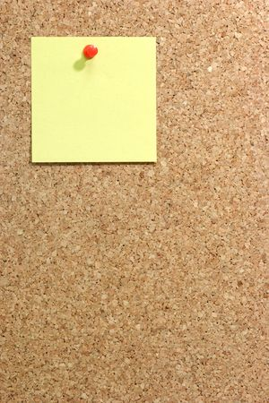 affixed:  Colorful blank post it note affixed to the corkboard. Stock Photo
