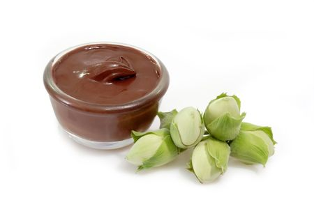 calorific: Chocolate creme with hazelnuts on bright Background