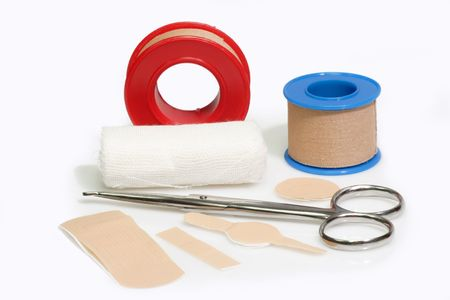 First aid kit and bandageon a bright background. Stock Photo