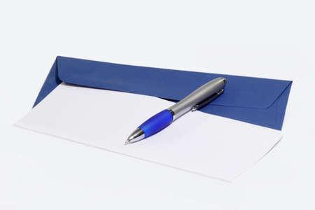 ballpen: Ballpen on letter and blue envelope on bright background Stock Photo