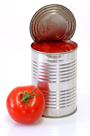 Can of peeled tomatoes on bright background Stock Photo