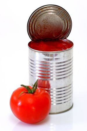 canned: Can of peeled tomatoes on bright background Stock Photo
