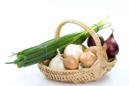 sorts: Different sorts of onions in a basket on bright background
