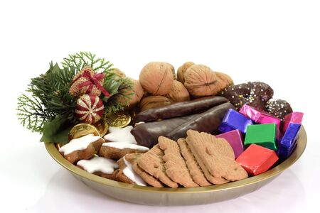 goodies: Plate of different christmas goodies on bright background Stock Photo