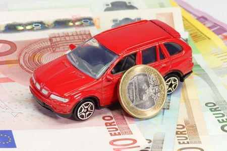 alimony: Red Toy car with Euro banknotes