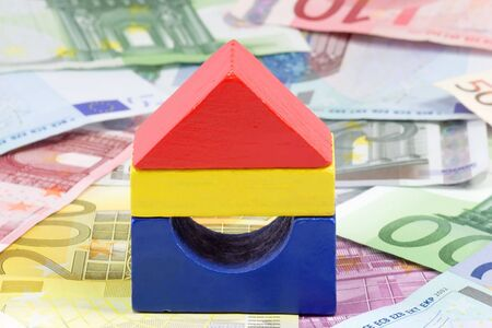 bilding: Colorful toy brick house with Euro banknotes