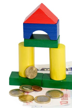 economise: Colorful toy brick house with Euro banknotes