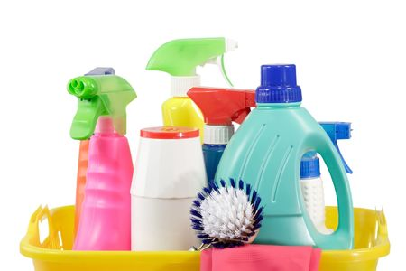 woman squirt: Cleaning supply bottles in a basket, isolated on white background Stock Photo