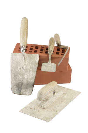 handtools: Various types of trowels and red bricks - isolated on white background