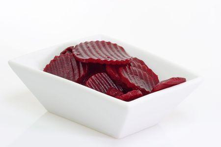 Boiled beetroot slices on dishware.