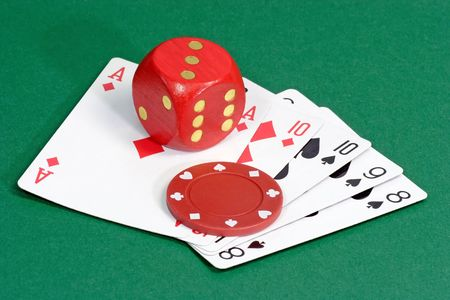 Red Dice with playing cards on green background photo
