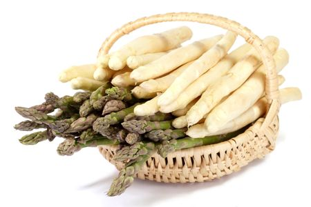 Basket of white and green asparagus on white background photo