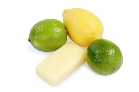 Yellow soap with lemon and lime on white background photo