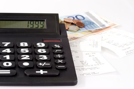 cash slips: Desk calculator, sales slips and money on bright background