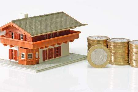 bilding: Toy house with euro coins on bright background