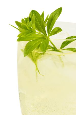 sweet woodruff: Punch with sweet woodruff herbs on bright background