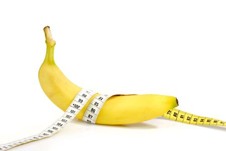 Bananas with tape measure on bright backgorund
