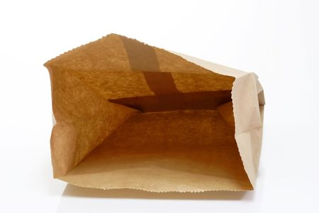 Recycled paper bag on bright background Stock Photo
