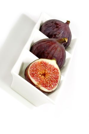 purple fig: Purple figs on bright background Stock Photo