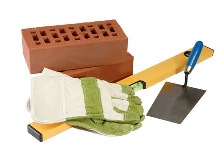 Masons equipment with bricks and sand - isolated on white background Stock Photo