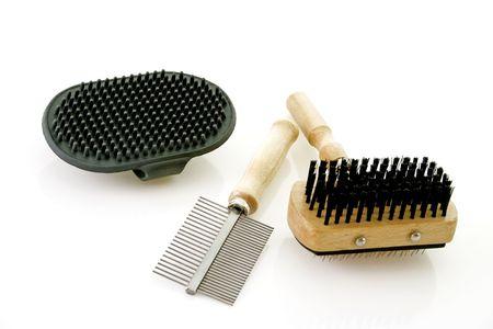 Dog brushing tools on bright background photo