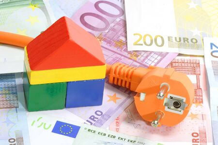 Euro banknotes with toy house and power cable Stock Photo - 3333270