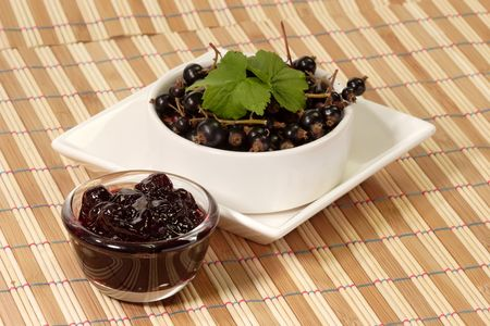 black currants: Black Currants with jam on colorful background