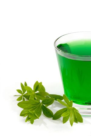 breen: Close-up of woodruff juice in a glass and leaves