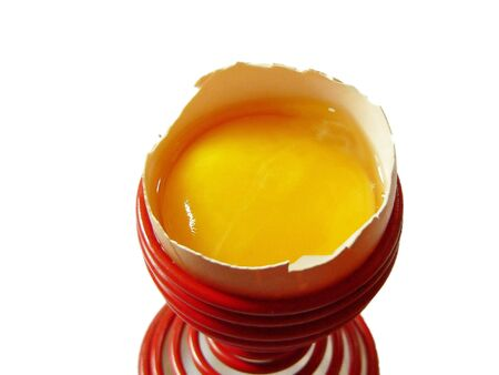 Broken egg in a egg cup on white background Stock Photo - 3522313